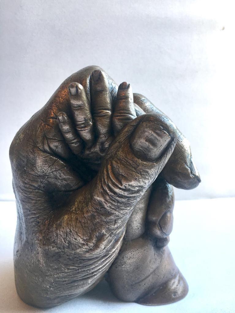 Bronze hand clasp