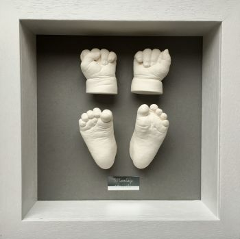 Baby hands and feet framed