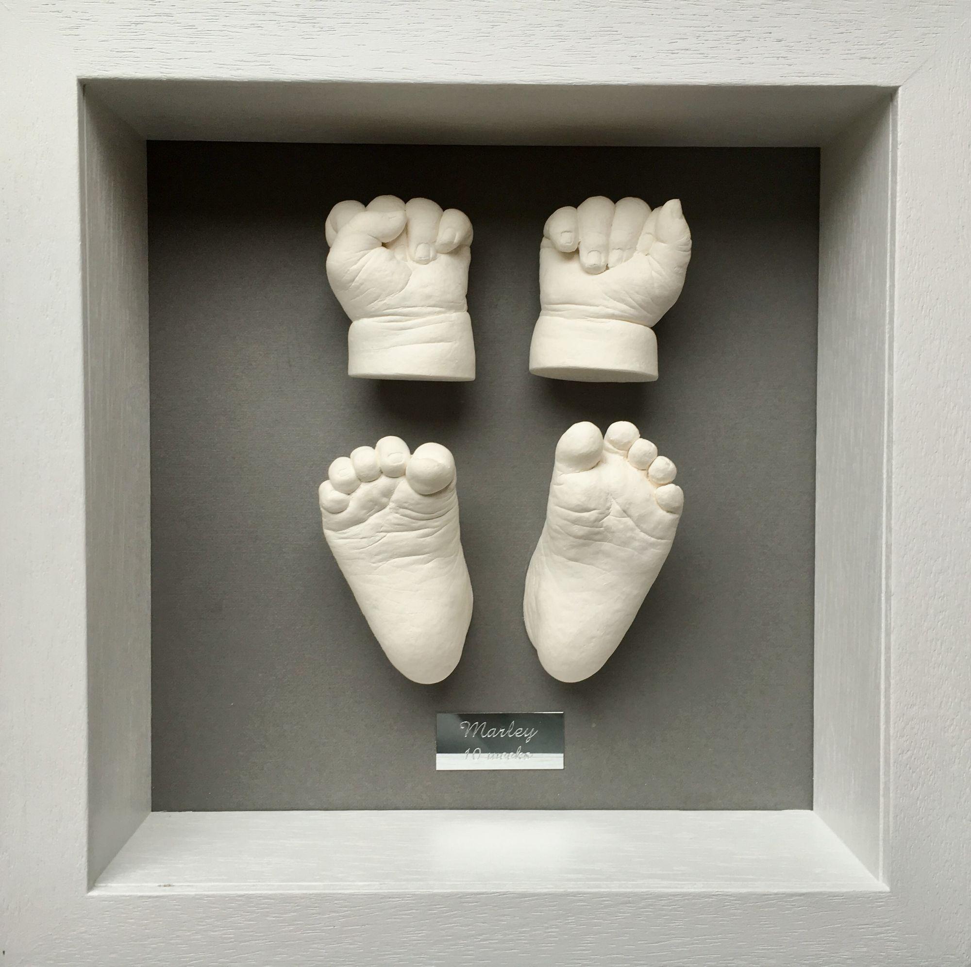 plaster hands and feet framed