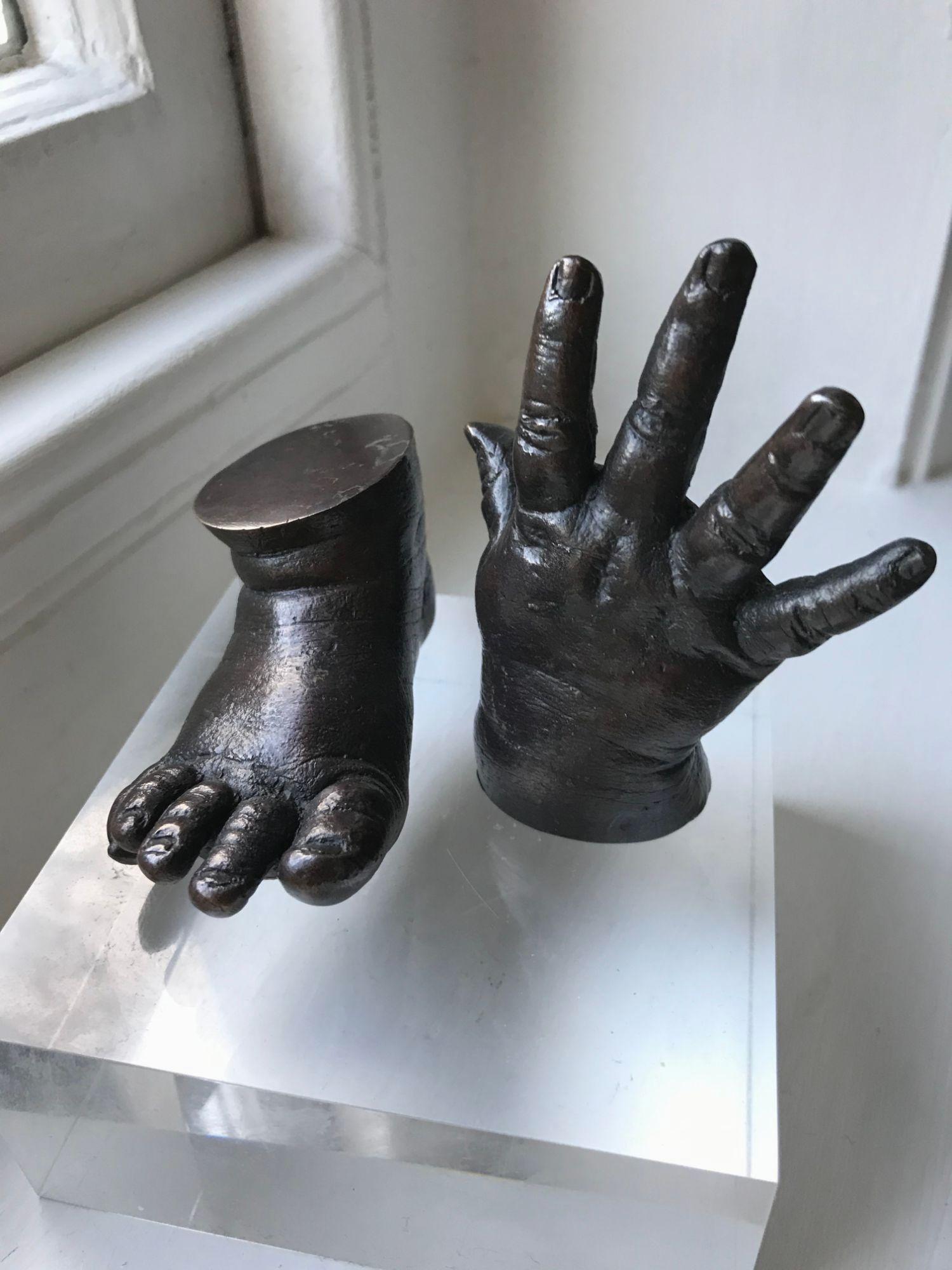 patinated open hand bronze