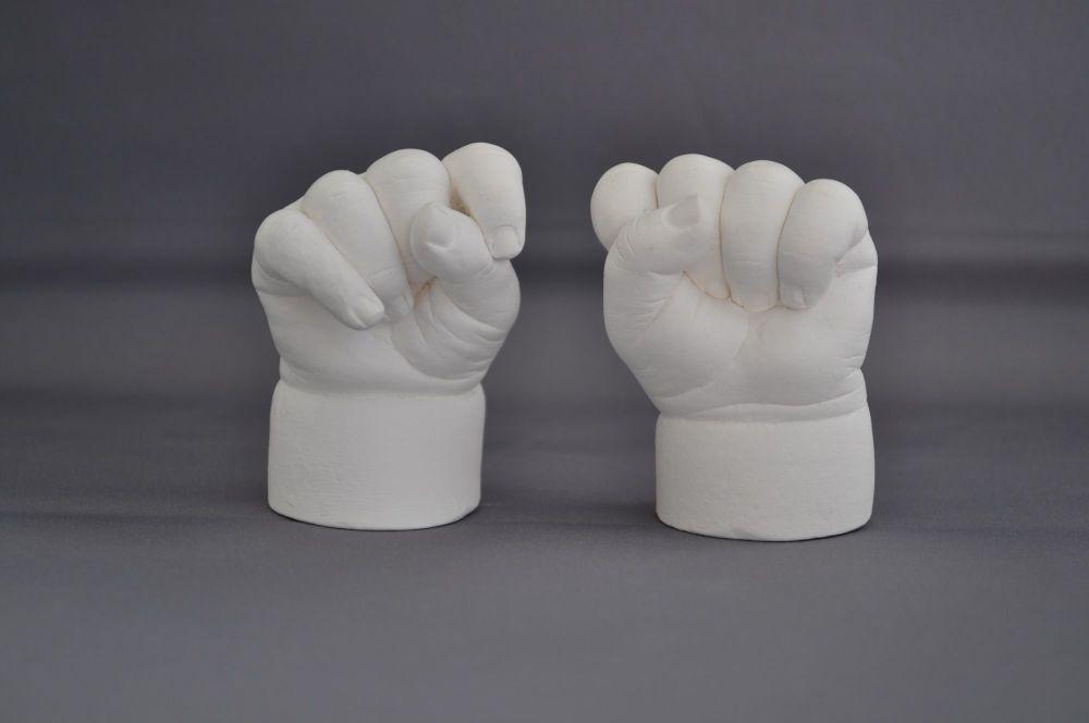 Pair of baby hands cast in plaster