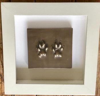 Bronze resin paw prints framed