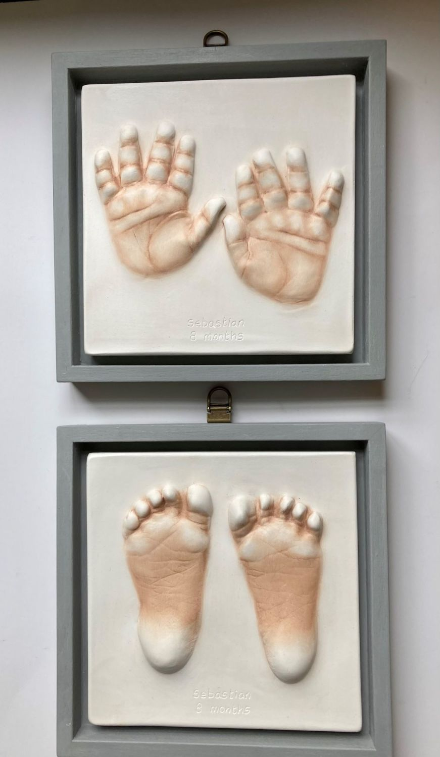 2 small baby impressions in open frame