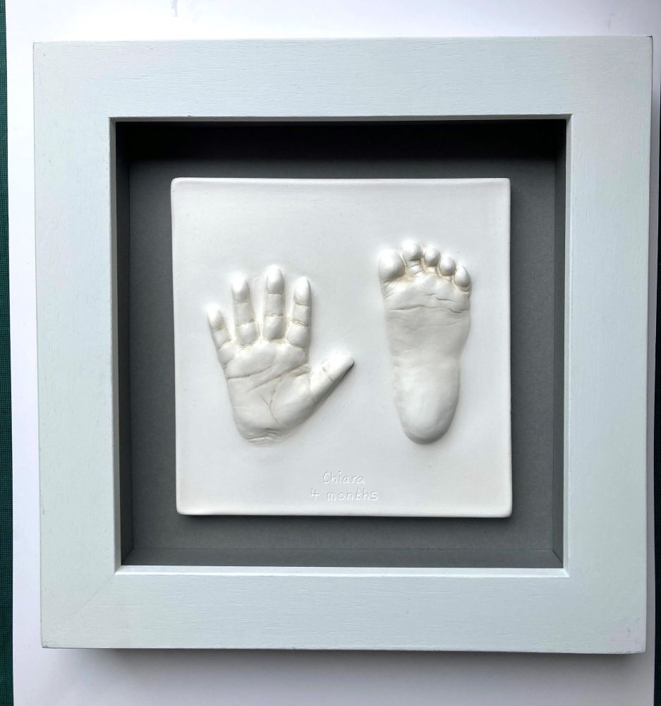 white impression casting framed