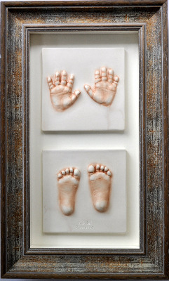 2 small impressions in a bevelled frame