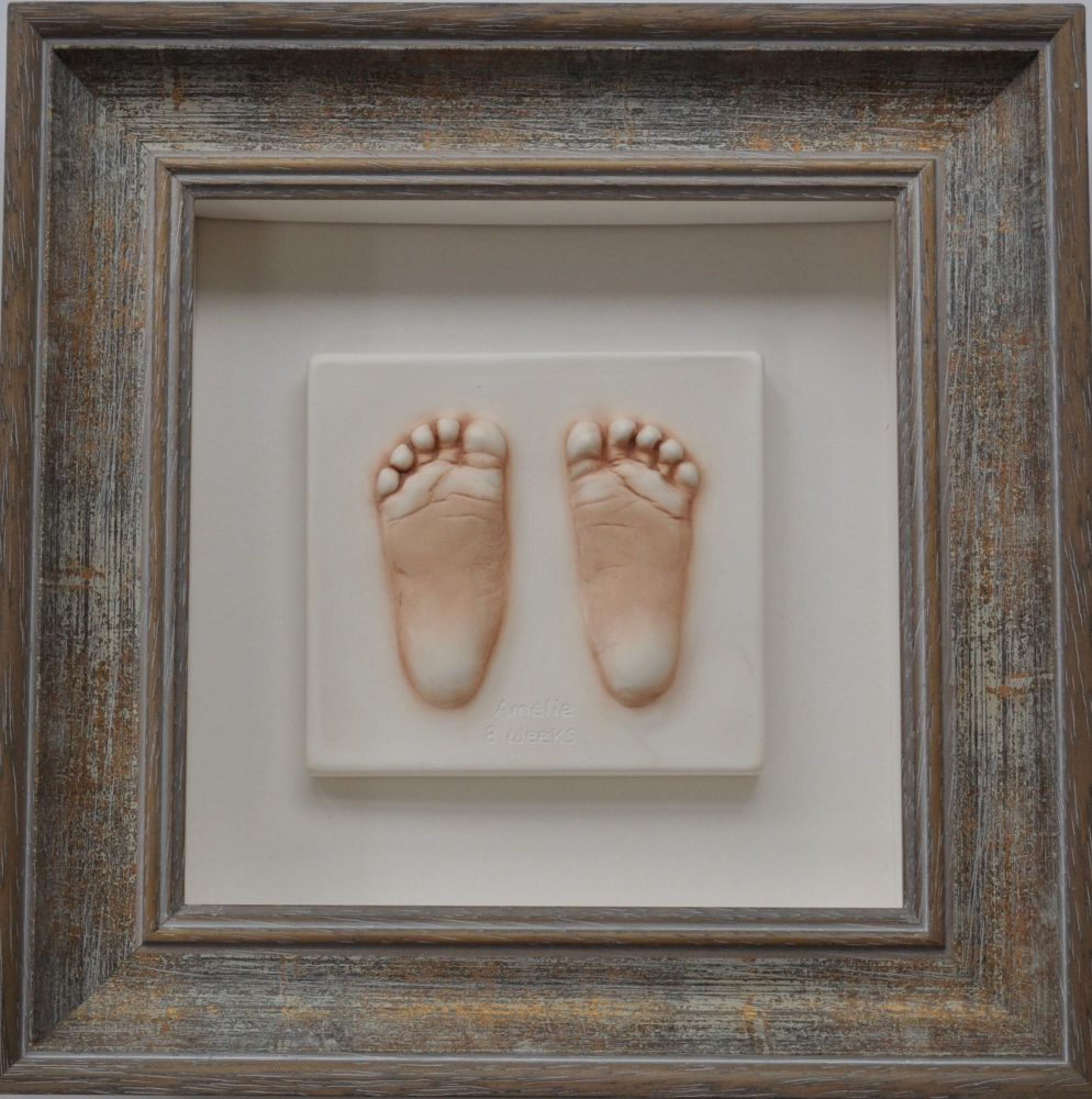 Extra small impression in a bevelled frame with soft white mount