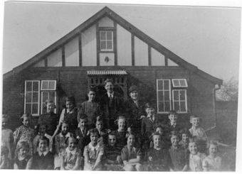 Pastor Quenby and congregation around 1940