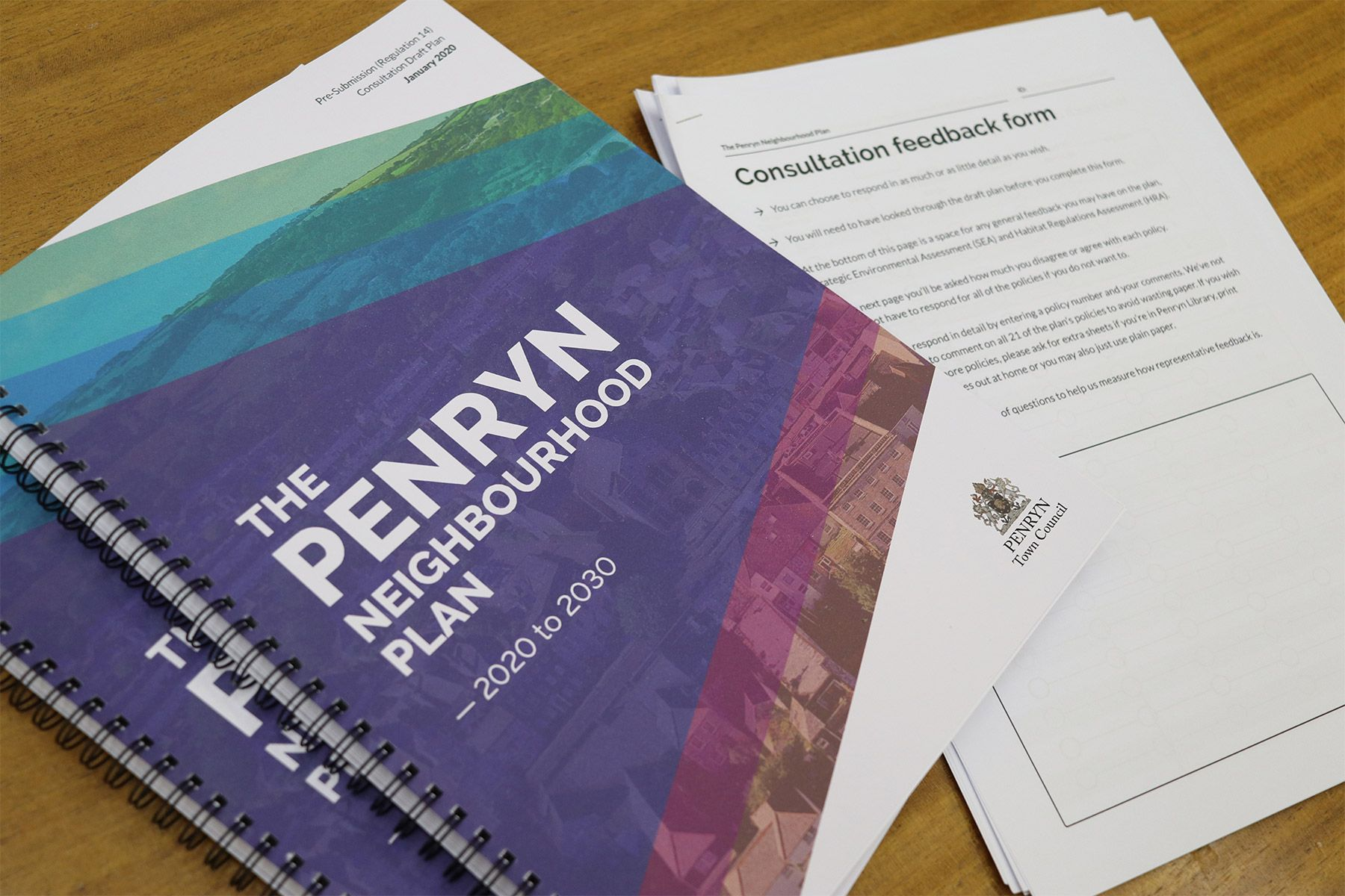 Printed copies of the Penryn Neighbourhood Plan alongside some paper feedback forms
