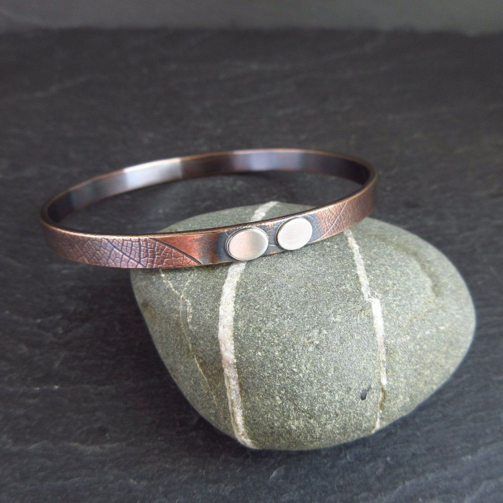 Bronze Bangle with Sterling Silver Oval Decoration