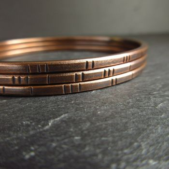 Oval Bronze Bangles with Line Decoration and Square Wire