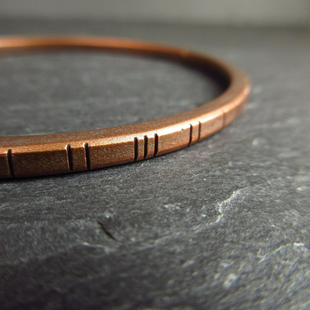 Oval Copper Bangle with Stamped Line Decoration - Square Wire