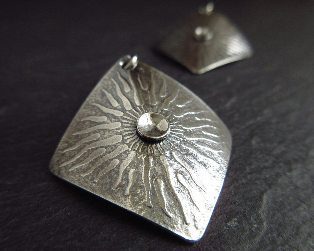 sterling silver earrings with sunburst texture