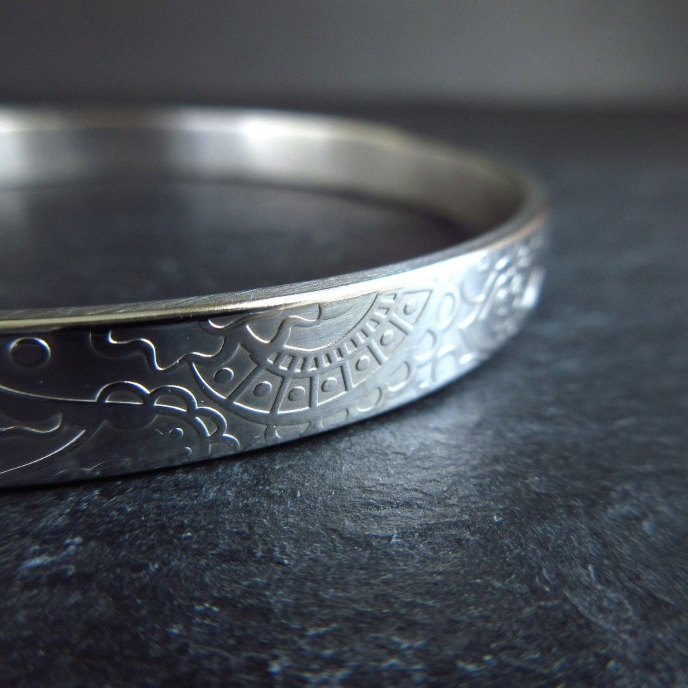 Flat Sterling Silver Bangle with Embossed Flower and Swirl Pattern
