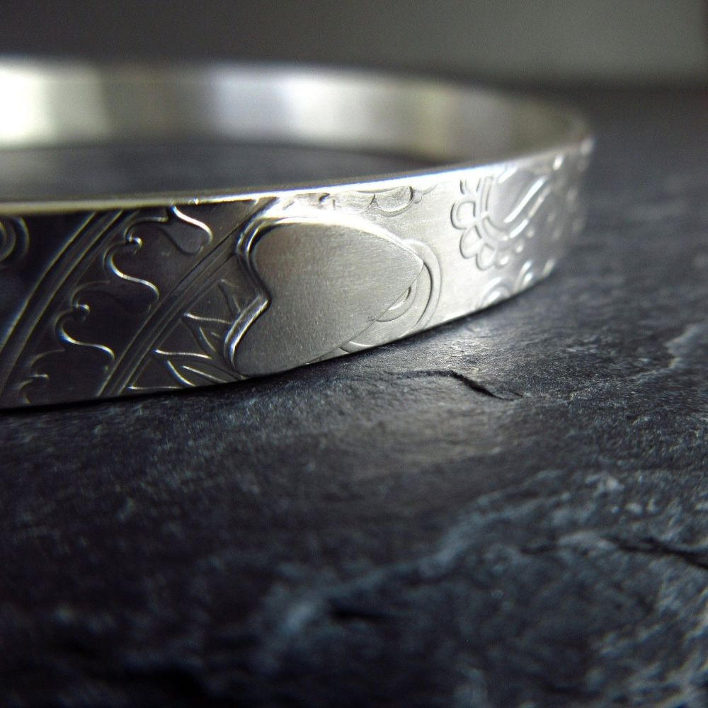 Sterling Silver Bangle with Silver Heart and Embossed Swirl Pattern