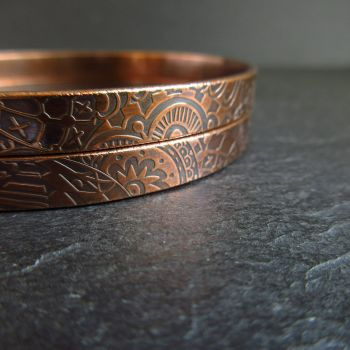Two Copper Bangles with Embossed Surface Pattern