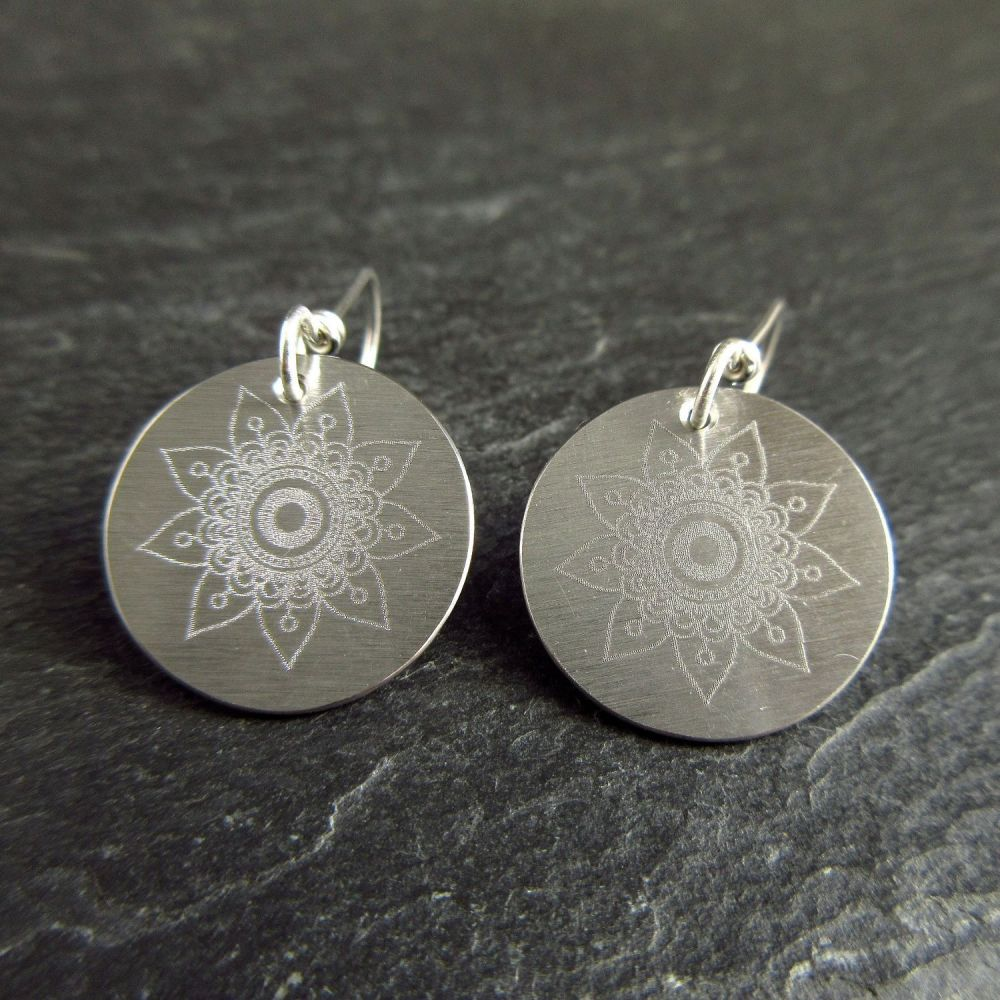 Stainless Steel Disc Earrings with Nine Petal Flower Design