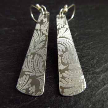 Stainless Steel Paddle Earrings with Leaf and Dots Design
