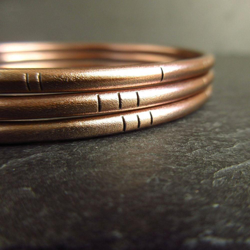 <!--04--> Bronze Bangles