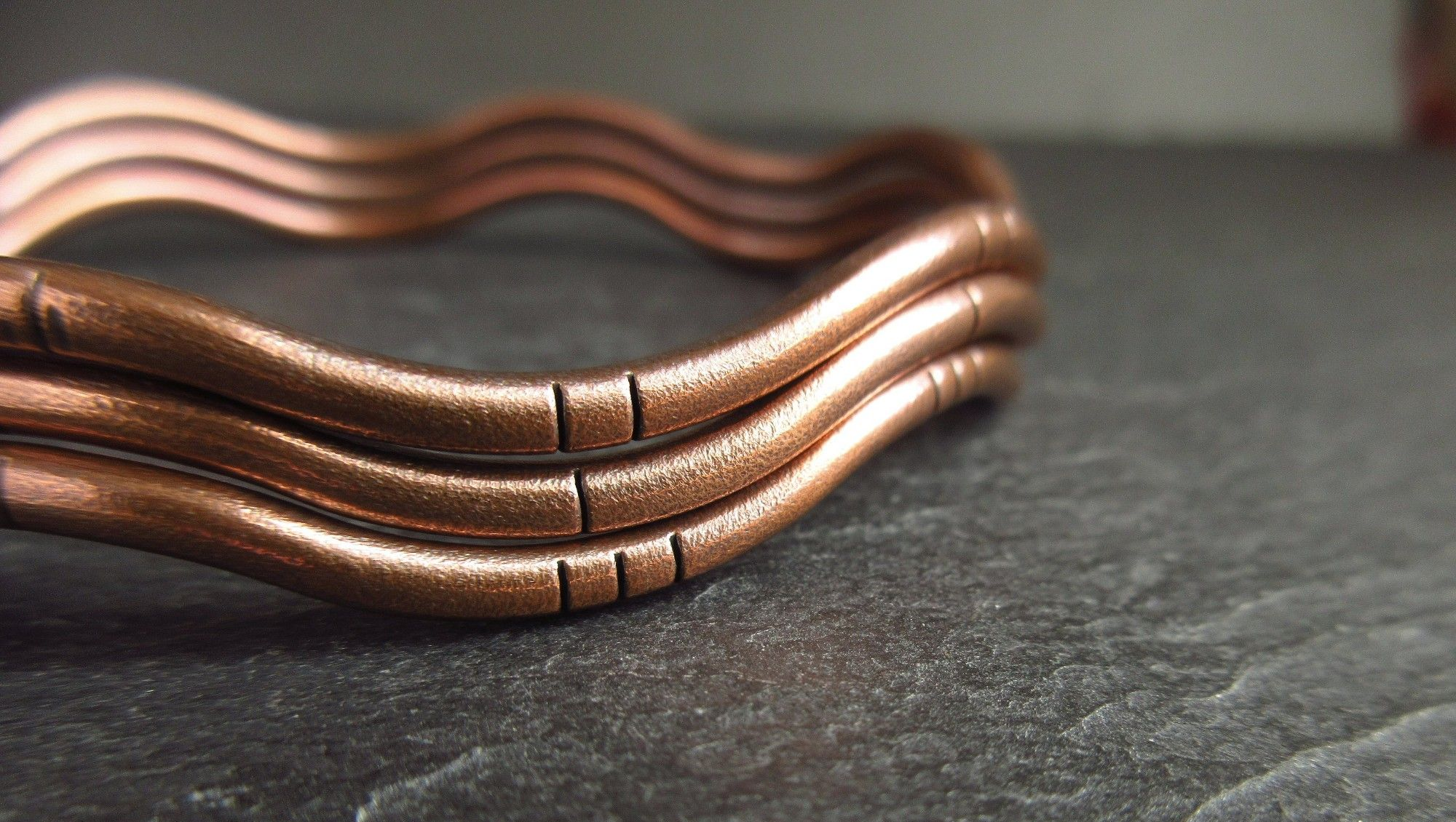 wavy copper bangles
