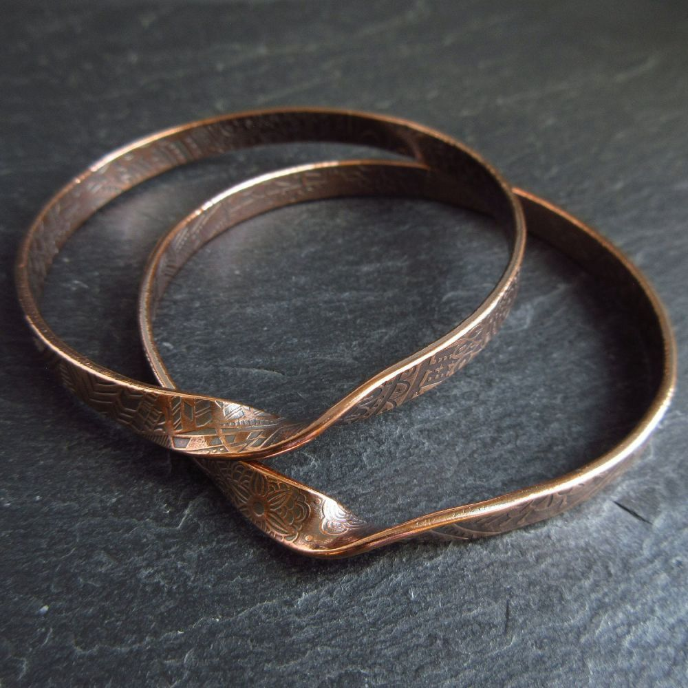 Two Copper Bangles with Twist Design Mobius Style