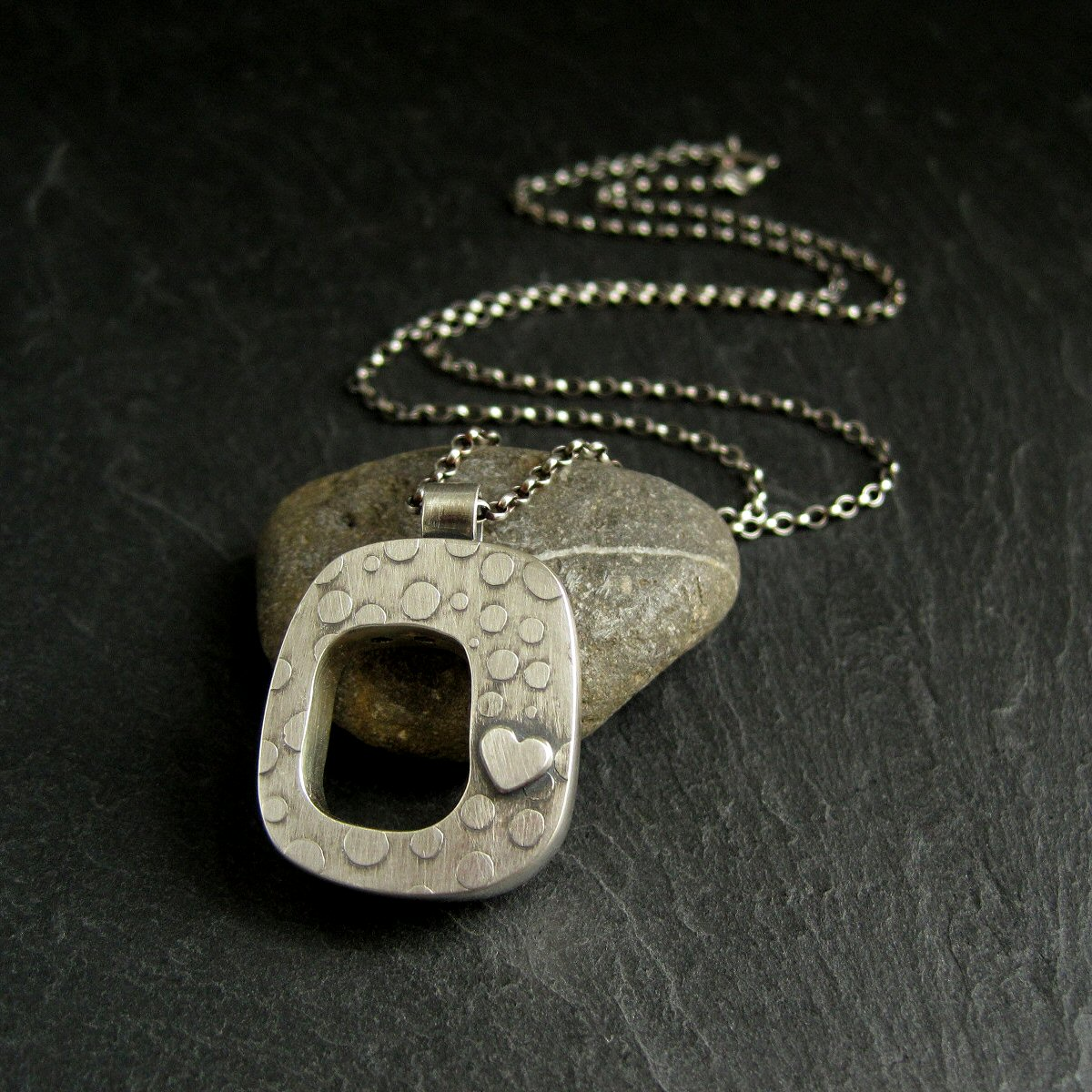 Sterling Silver Hollow Form Pendant with Silver Heart