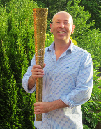 hypnotherapist mark powlett with the olympic torch