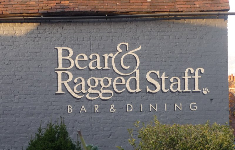 bear & ragges staff - signwriting on brickwork