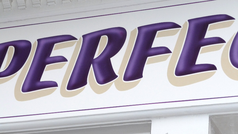close of airbrushed letters with shadow