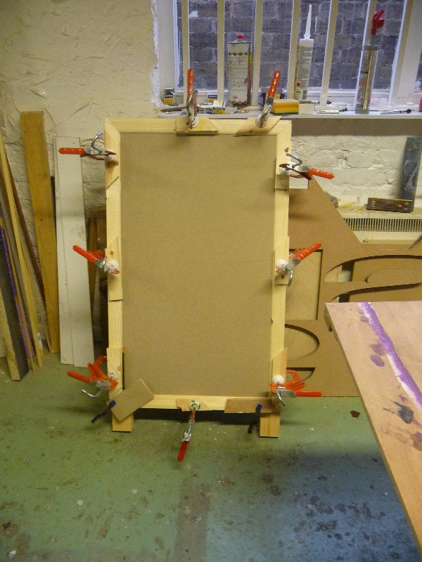 glued and pinned and clamped a-board