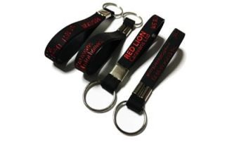 Red Lion Caravans - Custom Printed Debossed Keyrings by Promo-Bands.co.uk