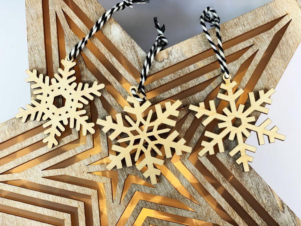 Set of three snowflake Christmas decorations