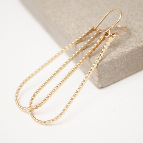 Long gold beaded hoops