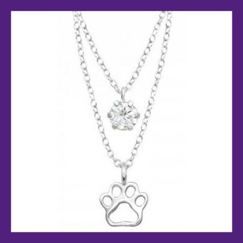 Little Paw prints on my heart, sterling silver paw print layered with a shining bright cubic zirconia. Necklace length 18""