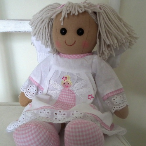 Seated traditional, soft-bodied rag doll Angel