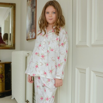 Girl's Long Sleeved Cotton Pyjamas With An All Over Pink Roses Print