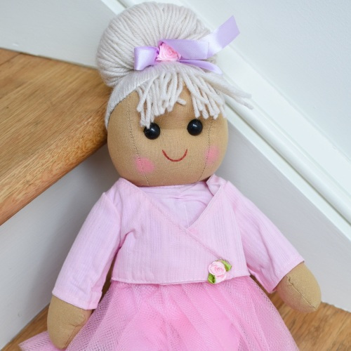 A traditional, soft-bodied rag doll dressed as a ballerina