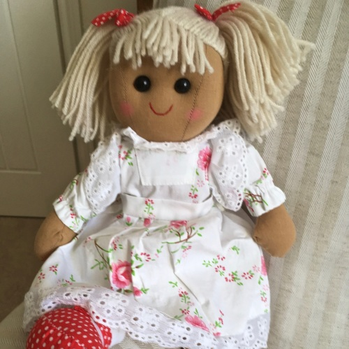 Traditional, soft-bodied rag doll in a pink & white floral dress
