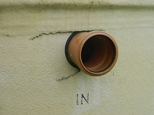 Cracked fibreglass around the outlet pipe.