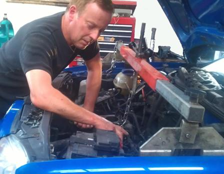 Nick of NC Motors removing an engine at his workshop
