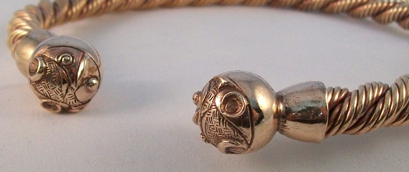 Celtic Ball design bronze torc close up of terminal