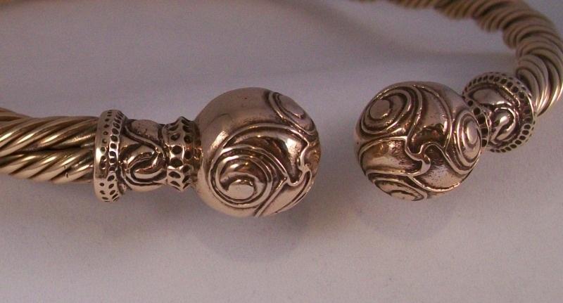 spiral ball bronze torc. close up detail of terminal