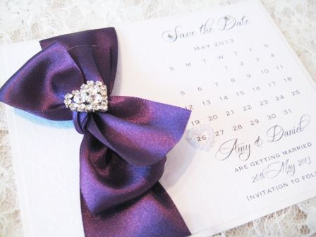 Save the date card with purple bow and diamante heart