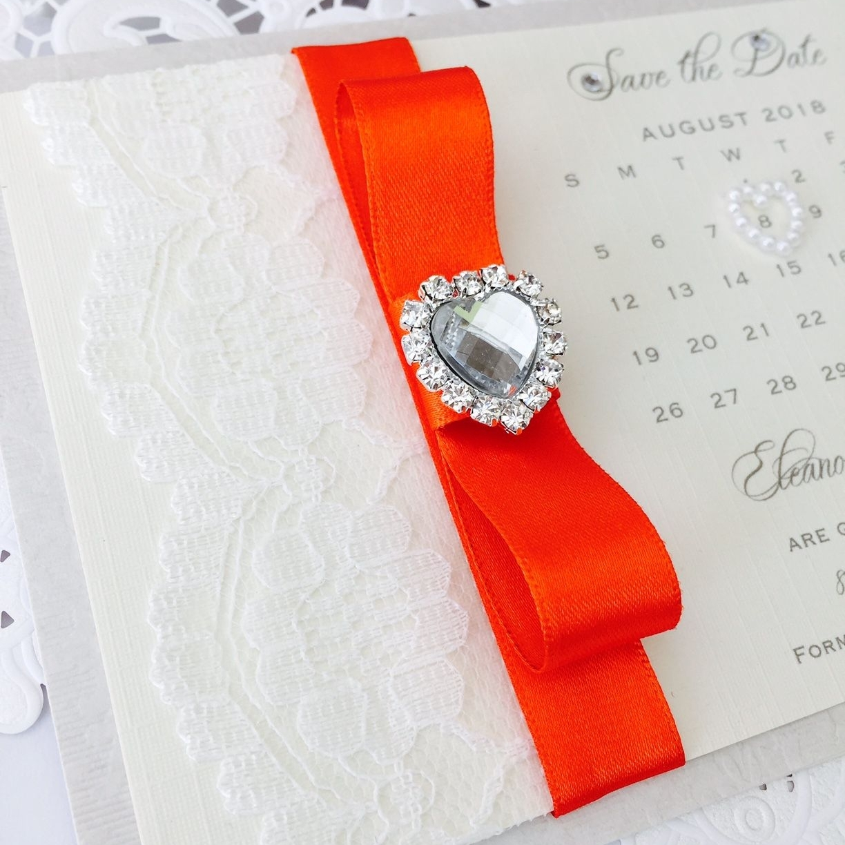 Save the date wedding calendar with orange ribbon and a crystal heart