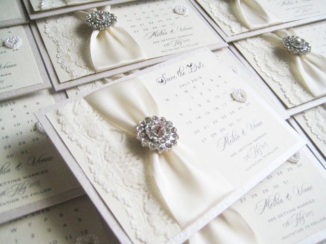 Vintage style save the date wedding calendar decorated with vintage crystal brooch and ivory lace