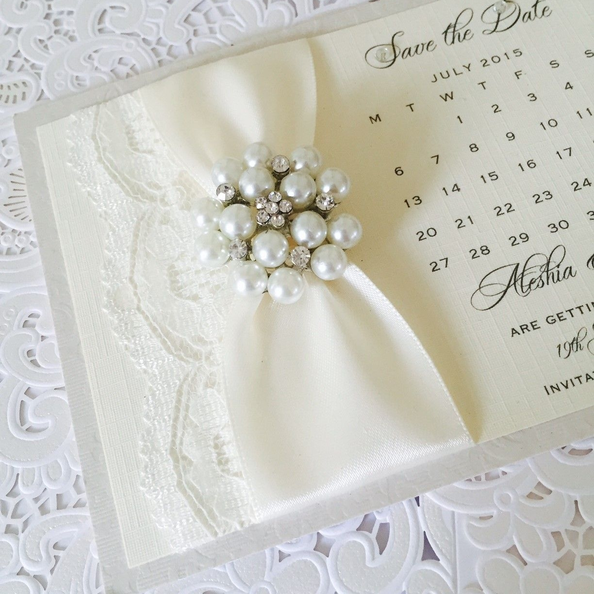 Vintage style save the date card with ivory lace and brooch