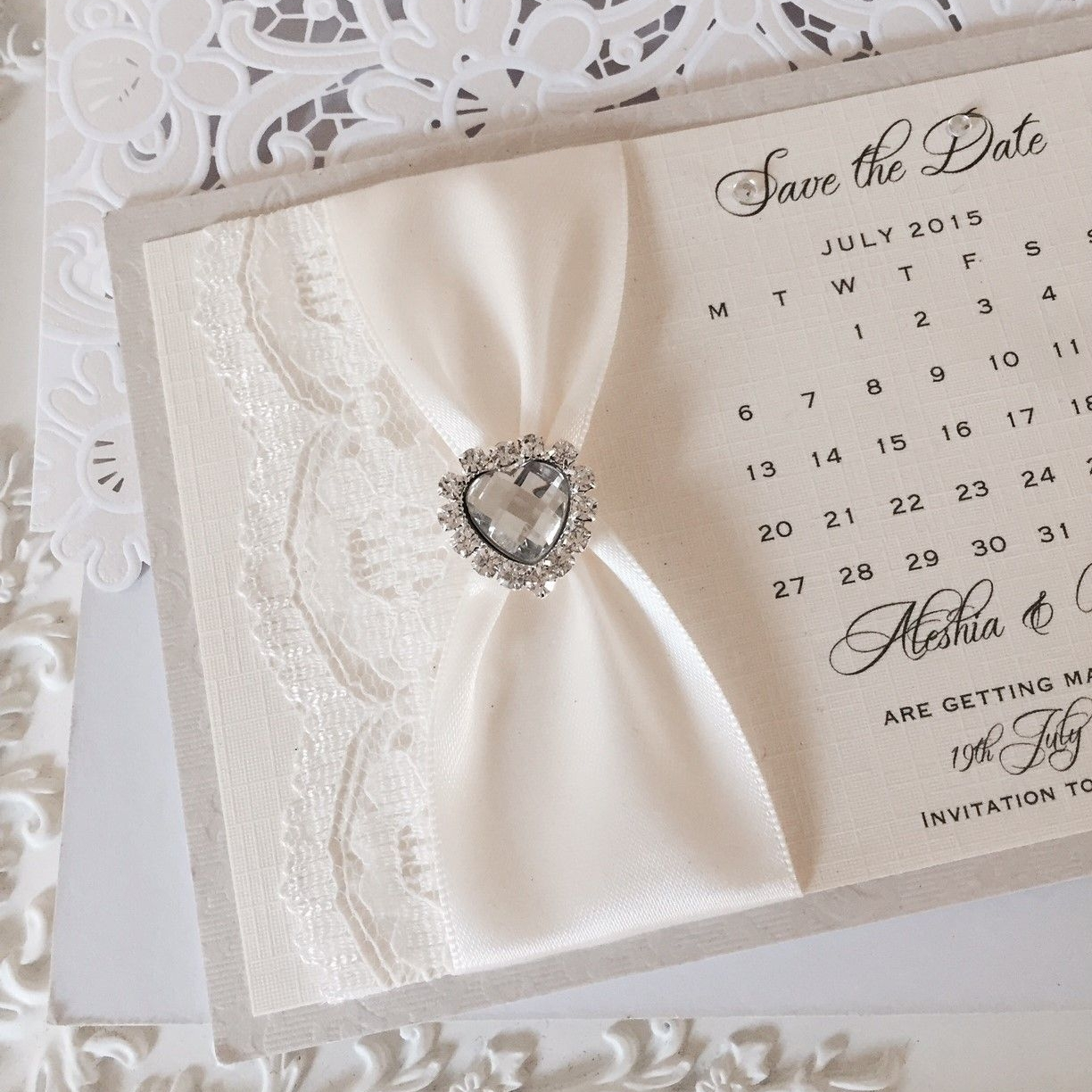 Ivory save the date wedding calendar with lace and diamante heart