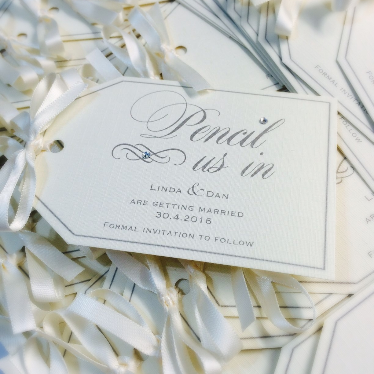 Save the date luggage tags with ivory bow ribbon