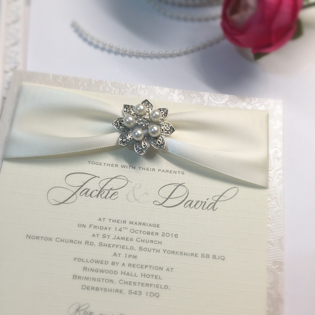 postcard style invitation for evening guests with ivory ribbon and pearl brooch