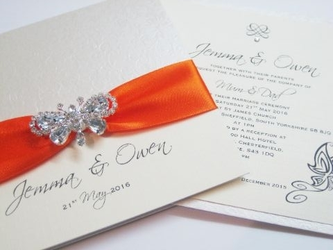 Butterfly wedding invitations with orange ribbon