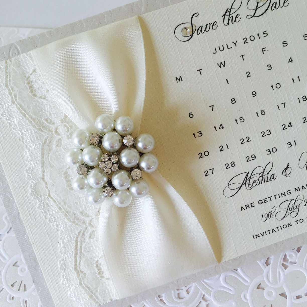 Save the date card designs with brooches